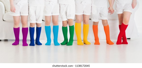 841293d13ee57 Kids wearing colorful rainbow socks. Children footwear collection. Variety  of knitted knee high socks