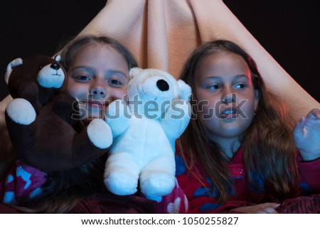 Kids wearing red jammies in bed on black background. Girls with happy faces  playing with 86cf54a58