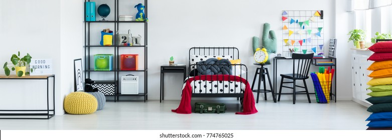Kids white bedroom with colorful decoration and accessories