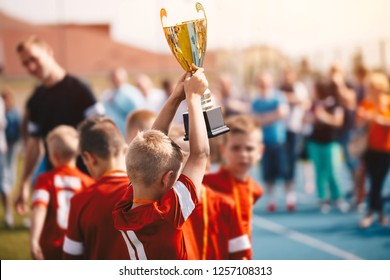 Kids Winning Sports Competition. Children Soccer Team with Trophy. Boys Celebrating Football Championship in Primary School Fooutball Tournament