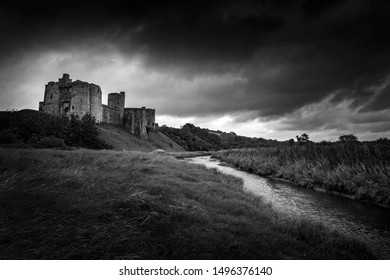 Kidwelly Castle, Kidwelly, Carmarthenshire, Wales, UK a Welsh ruin medieval castle of the 13th century black and white monochrome image