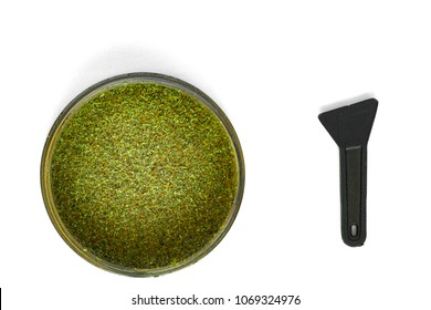 Kief in grinder for weed macro top view isolated on white backgr