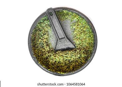 Kief in grinder for weed Trichomes buds of Cannabis macro top view