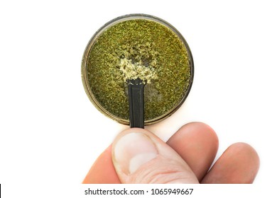 Kief in grinder for weed Trichomes buds of Cannabis And the hand