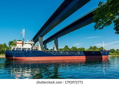 Kiel, Germany, Aug 8, 2020 - Brisk shipping traffic in the Kiel Canal, one of the busiest artificial waterways in the world, here under the Holtenau high bridge