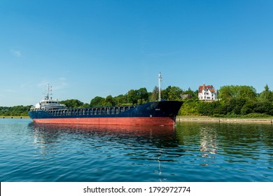 Kiel, Germany, Aug 8, 2020 - Brisk shipping traffic in the Kiel Canal, one of the busiest artificial waterways in the world