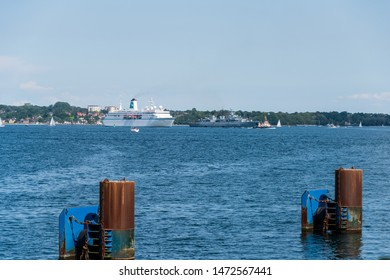 """Kiel, Germany, August 03, 2019 - Meeting in the Kiel Fjord, the frigate of the German Navy """"Mecklenburg-Vorpommern"""" and the cruise ship """"MS Deutschland"""""""