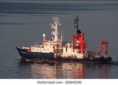 Kiel, Germany - July 21, 2013: The Poseidon, a research vessel of the Institute of Marine Sciences is leaving port in Kiel.