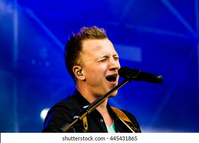 Kiel, Germany - June 19th 2016: The singersongwriter Joris  performs with his band on the Hoern stage during the Kieler Woche 2016