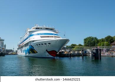 Kiel, Germany, June 29, 2019 - The AIDA prima of the AIDA Cruises at the Baltic Sea quay in Kiel, at the same time as the sister ship AIDA cara at the Baltic Sea quay for Kiel Week