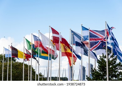 Kiel, Germany, March 18, 2021 - In the apron of the Olympic port in Kiel Schilksee, the flags of the participating nations in a sailing regatta