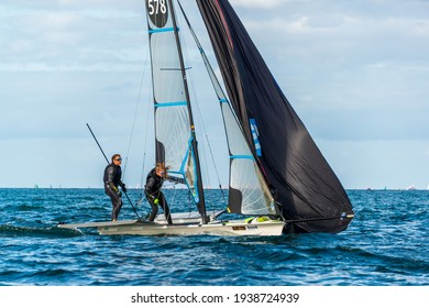 Kiel, Germany, March 18, 2021 - Regatta of sailing dinghies of the Olympic classes in front of Kiel-Schilksee in the Baltic Sea
