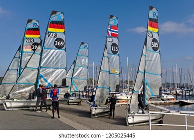 Kiel, Germany - September 9th, 2018 - Several 49er FX dinghies on the shore with their crew after training