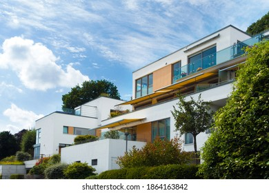 Kiel, Schleswig-Holstein, Germany, August 25, 2020: white modern cubic terraced housing estate with terraces and balconies