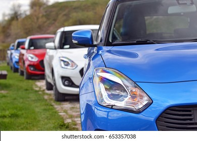 Kielce, Poland - April, 13, 2017: Suzuki Swift cars parking in a row on the street during exhibition.