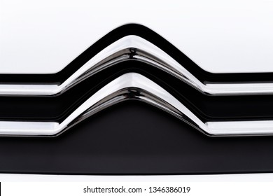 Kielce, Poland, March 16, 2019:  New Citroen Auto emblem on a car grill in close-up. Citroen is a famous French automobile manufacturer, part of the PSA Peugeot Citroen group.