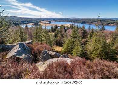 Kielder Forest / Kielder Reservoir in Northumberland. High on the rocks looking over the tree-tops towards the reservoir. Kielder dam is known for its hydroelectric plant, opened in 1972.