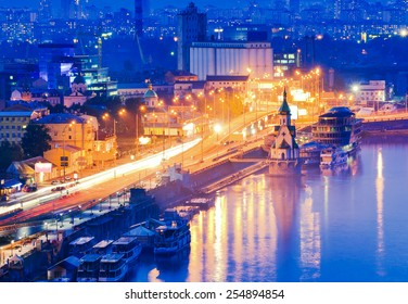 Kiev city, Capital of Ukraine. Night View of the Dnieper river, River station, an old embankment and Church of Saint Nicholas (on the water) in Kyiv.