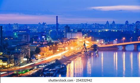Kiev city, Capital of Ukraine. View of the Dnieper river, River station, Havana bridges and Naberezhno-Kreschatitska street. Night panorama of Kyiv.
