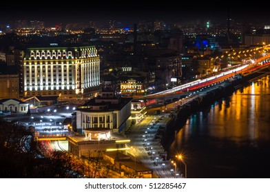 Kiev city in Ukraine at night beside the rive with reflection in water