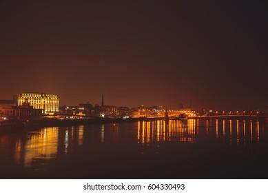 Kiev night view on river port, lights of night city