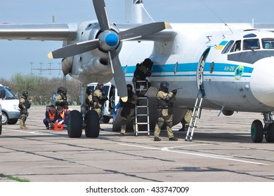 Kiev Region, Ukraine - April 24, 2012: Special operations sercice squad during the counter-terrosist training with a captured aircrafts with medics helipng the victims on the background