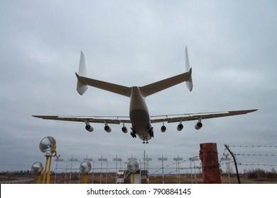 Kiev Region, Ukraine - January 8, 2012: Antonov An-225 cargo plane is landing on sunset