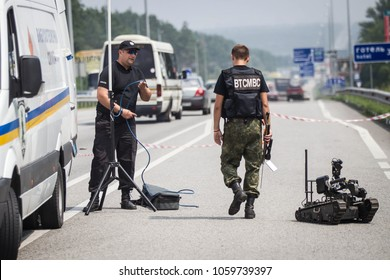 KIEV REGION, UKRAINE - July 26, 2016: Robot of explosive technical service of National Police of Ukraine inspect the road after an anonymous report on mining of a public transport stop in Kiev region.