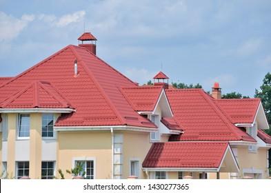 Kiev region, the village of Petropavlivska Borshchahivka - 04/12/2018. The house is made of red metal roofing.