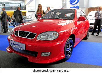 "KIEV - SEPTEMBER 10: Yearly automotive-show ""Capital auto show 2010"". September 10, 2010 in Kiev, Ukraine. Red Daewoo Lanos"