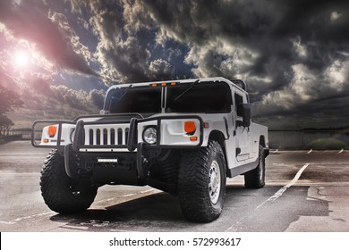 Kiev. September 9, 2016; Hummer H1 against the backdrop of a thunderstorm. Cloudy sky. Military equipment. Military car.. Editorial photo.
