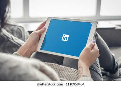Kiev, Ukrain - February 10, 2018: Woman using Linkedin app on a brand new Apple iPad Pro Silver, 7th generation of the iPad, developed by Apple inc. and was announced on March 21, 2016
