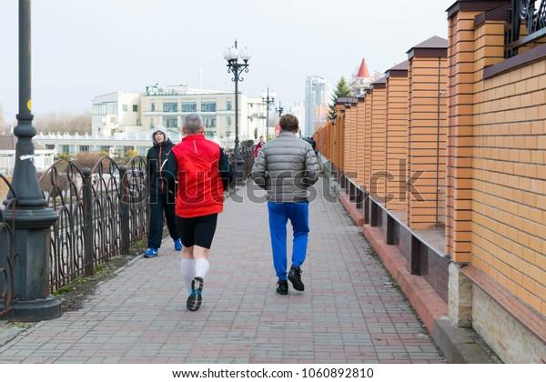 Kiev, Ukraine - 01, April, 2018: Walking people on the Obolonskaya embankment
