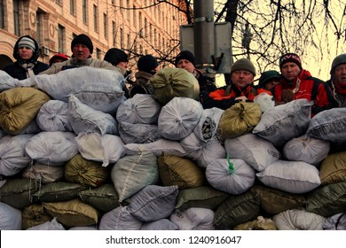 Kiev / Ukraine - 01.23.2014: Ukrainian opposition activists and defenders of euromaidan on the barricades of sandbags waiting for the onslaught of special forces on Grushevsky street.