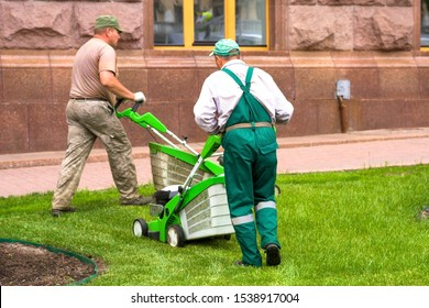 Kiev, Ukraine. 05/17/2018. The man with the lawn-mower mows a lawn. turfgrass care. mowing grass-plot. Lawnmowers. Improvement of lawns