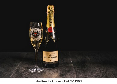 Kiev, Ukraine - 07 November 2018. Moet & Chandon champagne bottle on a stone table. Near a glass of champagne