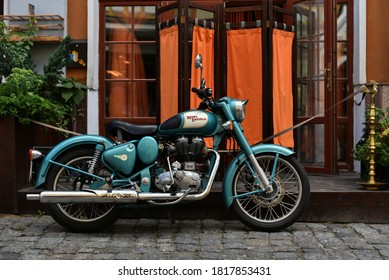 Kiev / Ukraine - 07.18.18: Motorcycle of brand Royal Enfield Classic 500 parked near barber shop
