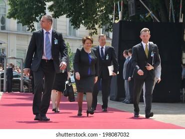 KIEV, UKRAINE - 08 JUNE 2014: The prime minister of Latvia Laimdota Straujuma with security visit the inauguration of Ukrainian President Petro Poroshenko on June 08, 2014 in Kiev, Ukraine