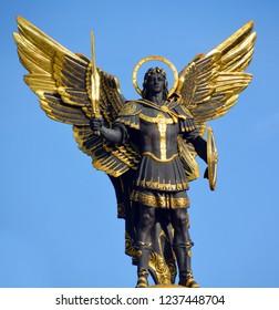 KIEV UKRAINE 09 03 17:  Gold plated bronze statue of Archangel Michael Saint patron of Kiev in independence square (Maydan Nezalezhnosti)