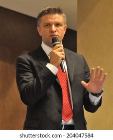 KIEV, UKRAINE - 09 JULY 2014: Dmytro Shymkiv - the deputy of the head of Ukrainian Presidential Administration make a speech on national forum with NGOs on July 09, 2014 in Kiev, Ukraine