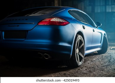 Kiev, Ukraine - 14 may 2014: Porsche Panamera blue in old factory. porsche panamera back view.