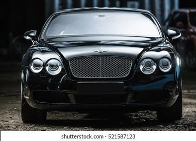 Kiev, Ukraine - 14 May 2014: Bentley Continental GT Coupe tuning sport-car. It colored in black color. Editorial photo. Front view.