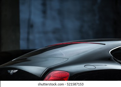 Kiev, Ukraine - 14 May 2014: Bentley Continental GT Coupe tuning sport-car. It colored in black color. Editorial photo. Closeup back view.