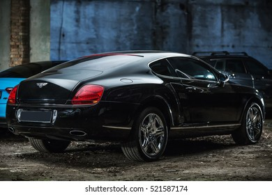 Kiev, Ukraine - 14 May 2014: Bentley Continental GT Coupe tuning sport-car. It colored in black color. Editorial photo. Shoot from the back.