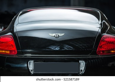 Kiev, Ukraine - 14 May 2014: Bentley Continental GT Coupe tuning sport-car. It colored in black color. Editorial photo. Shoot from the back. Closeup.