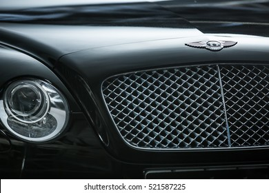 Kiev, Ukraine - 14 May 2014: Bentley Continental GT Coupe tuning sport-car. It colored in black color. Editorial photo. Closeup view of the car radiator grille.