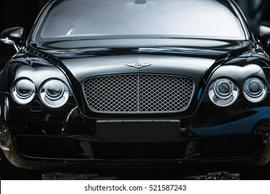 Kiev, Ukraine - 14 May 2014: Bentley Continental GT Coupe tuning sport-car. It colored in black color. Editorial photo. Closeup front view.