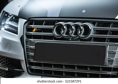 Kiev, Ukraine - 14 May 2014: Audi S7 tuning sport-car. Audi colored in white, black, gray colors with patterns. Editorial photo. Closeup view of the car radiator grille.