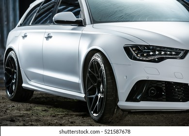 Kiev, Ukraine - 14 May 2014: Audi RS6 tuning sport-car. It colored in white color. Editorial photo. Closeup side view.