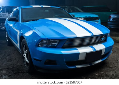 Kiev, Ukraine - 14 May 2014: Ford Mustang tuning sport-car. It colored in blue color with white stripes. Editorial photo.